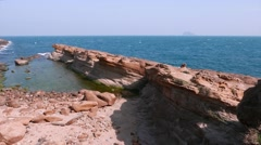 Close view of old-collapsed rock on the shore of Yehliu Geopark cape Stock Footage