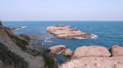 Rock in the water, Yehliu Geopark cape Stock Footage