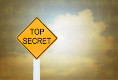 Road sign indicating Top Secret on blurred vintage background Stock Photos