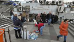 Souvenir painting seller at Eminonu underpass Stock Footage