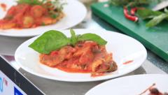 Chef decorate fish dish in a tomato sauce. Stock Footage