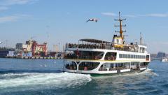 Slow Motion. Flock of sea birds following the city cruise ship, sailing to Kadik Stock Footage