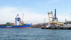 Seaport with containers and cargo ship. 4K Stock Footage