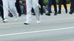 MARCHING BAND FEET IN A PARADE Stock Footage
