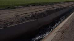 4K Water Irrigates Green Farm Field Crops Stock Footage