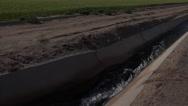 Stock Video Footage of 4K Water Irrigates Green Farm Field Crops