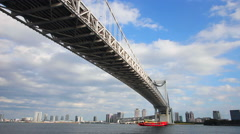 Under rainbow bridge at tokyo bay zoom shot - stock footage