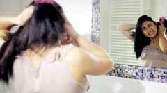 Young woman brushing her hair full of knots Stock Footage