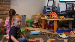 Kids playing at grandmas house in the living room Stock Footage