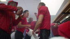 4K portrait smiling American footballer in team locker room after game win - stock footage