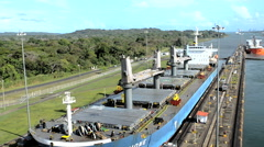 Ship driven by trains in the Panama Canal - stock footage