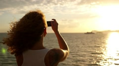 Woman Taking Pictures with Smartphone at Sunset. Slow Motion - stock footage