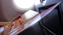 Woman Traveler Reading Airplane Menu and Choosing Meal Stock Footage