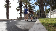 Beach promenade - People / tourists on vacation walking by Stock Footage