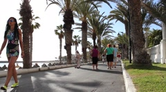 Stock Video Footage of Tourists at Beach promenade - People walking by
