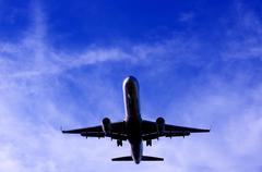 Silhouette of plane in flight Kuvituskuvat