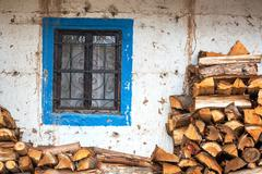 Firewood next to a blue and white colonial window in Tarma, Peru Stock Photos