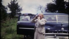 1981 - tourist stop roadside to take photos - vintage film home movie Stock Footage