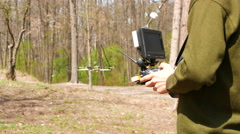 Man in a green sweater, drone operator  holding  transmitter. 4K 3840x2160 Stock Footage