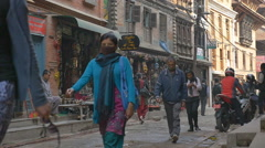 PATAN, NEPAL - MARCH 23, 2015 : Tourists on the road at Durbar square in Patan Stock Footage