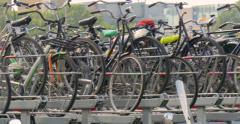 Bicycles parked mass group Holland Netherlands bicycle bikes cycles bike city Stock Footage