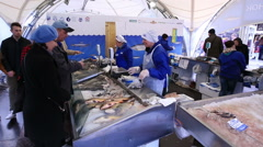 Buyers and sellers at the fish market. Stock Footage