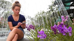 Young Pretty Girl Using Mobile Phone in Summer Park. Stock Footage