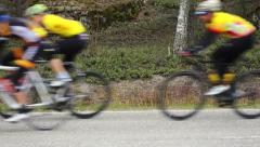 Racing cyclist driving by Stock Footage