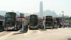 Hong Kong - Double Decker Bus Departs Ocean Terminal Bus Depot Stock Footage