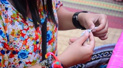 Thai woman Needlework or sewing cotton and textiles Stock Footage