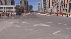Confusing intersection for drivers with construction and bus lane Stock Footage