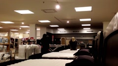Customer shopping mattress inside Sears store Stock Footage
