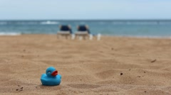 White beach - sand, ocean, blue sky - sun beds and duckling - stock footage