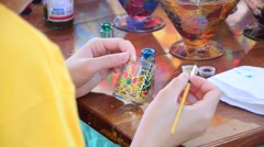 Children painting on glass paint Stock Footage
