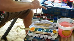 Thai man mix color for painting Stock Footage