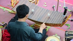 Thai people playing the ranat ek is a Thai musical instrument Stock Footage