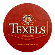 Texel coaster advertising the pure taste of Texel. Stock Photos