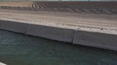 4K Water Irrigates Farm Field Crops - stock footage