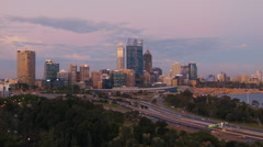 Perth City CBD and the Kwinana Freeway in the Dusk Light Stock Footage