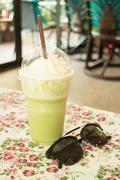 Glass of green tea latte frappe Stock Photos