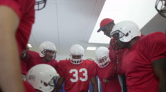 4K American football coach in locker room, psyching up players before the game - stock footage
