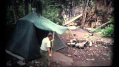(1960's 8mm Vintage) Man Setting Up a Old Camping Tent Stock Footage