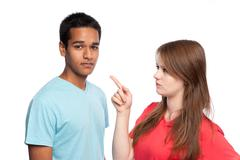 Stock Photo of Girl Pointing At Boy.