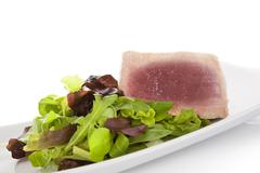 Tuna steak with salad. Stock Photos