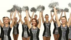 Beautiful dancing girls: cheerleading, pom-poms in hand, smile Stock Footage