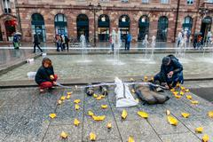 Stock Photo of STRASBOURG, FRANCE - APR 26 2015 Arranging Frontex line over dead corps prote