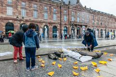 STRASBOURG, FRANCE - APR 26 2015 Arranging Frontex line over dead corps prote Stock Photos