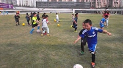 Chinese children in football training Stock Footage