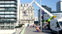 Bridge repairing service in Paris - worker in a nacelle of the crane Stock Footage