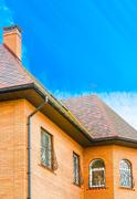 house with a gable roof window - stock illustration